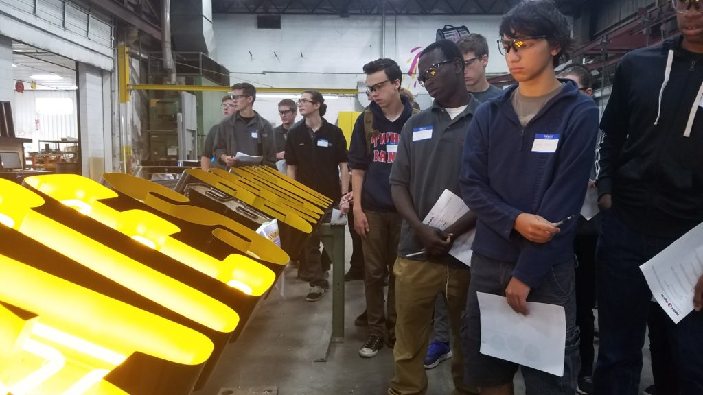 Students learn how flexible LED tubing is used to mimic an exposed neon look in open faced channel letters.
